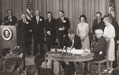 Harry S. Truman signing the Medicare bill